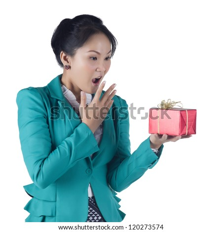 Portrait of beautiful Asian woman holding a gift box isolated on white background - stock photo