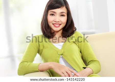 Portrait of beautiful asian woman on the sofa
