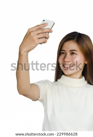 Portrait of Beautiful asian woman take a photo by smart phone against white background. - stock photo