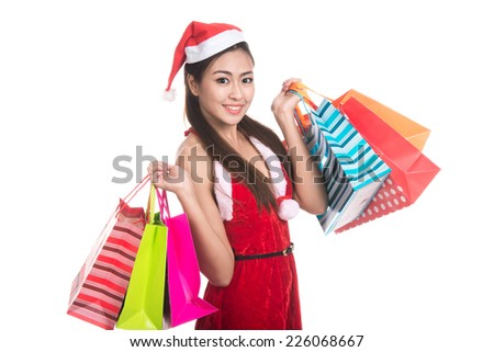 Portrait of beautiful Asian woman wearing Santa Claus clothes with holding shopping bags,christmas,x-mas,winter,happiness concept,Human face expressions,Positive emotions,isolated on white background