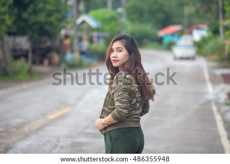 Portrait of beautiful asian young woman near the road