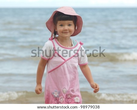 Portrait of beautiful baby by the sea - stock photo