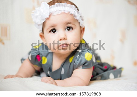 Portrait of beautiful  baby girl on white background  - stock photo