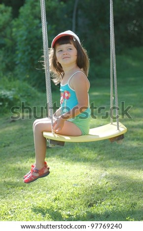 Portrait of beautiful baby on the swing - stock photo