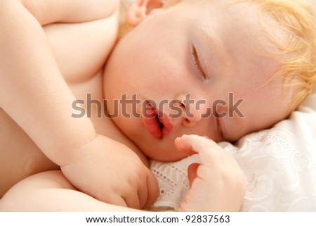 Portrait of beautiful baby sleeping peacefully - stock photo