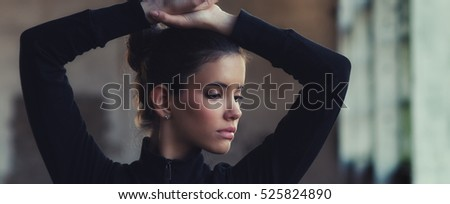 Portrait of beautiful ballerina during exercise outdoor.