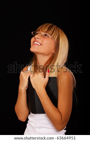 portrait of beautiful blond girl in glasses on black - stock photo