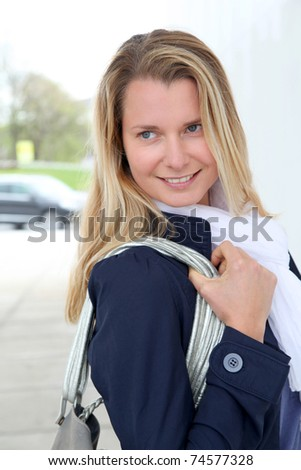 Portrait of beautiful blond woman in town