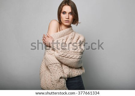 Portrait of beautiful blond woman in woolen sweater