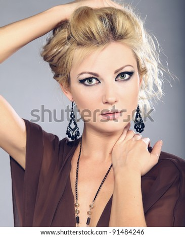 portrait of beautiful blond woman, studio shot - stock photo
