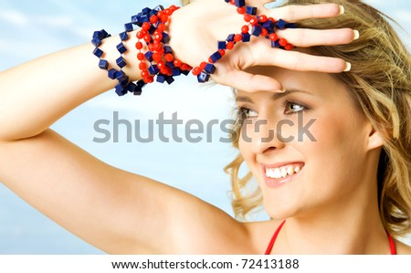 portrait of beautiful blond woman under bright light - stock photo