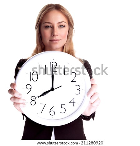 Portrait of beautiful blond woman wearing suit holding in hands clock, isolated on white background, eight o'clock, come to work in time  - stock photo
