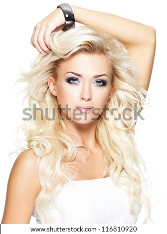 Portrait of beautiful blond woman with long curly hair - isolated on white - stock photo