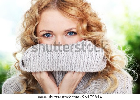 Portrait of beautiful blond woman with wool sweater - stock photo