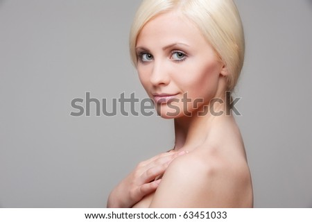 portrait of beautiful blonde over grey background