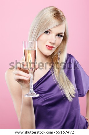 portrait of beautiful blonde party girl with glass of champagne on pink