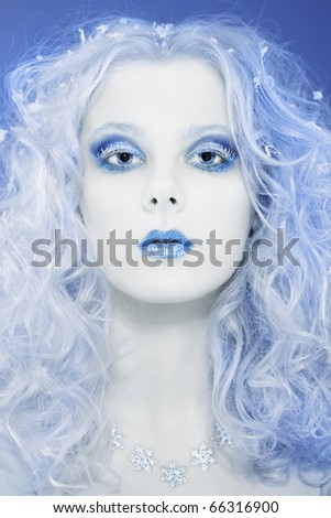 Portrait of beautiful blonde winter snow queen