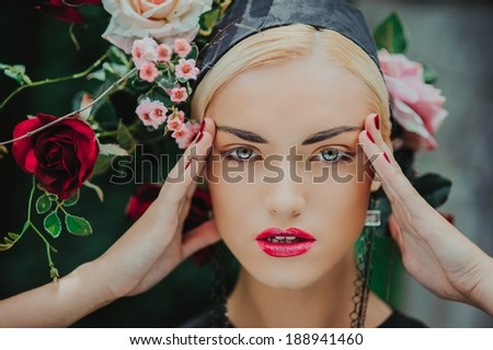 Portrait of beautiful blonde with a roses on her head  - stock photo