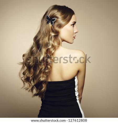 Portrait of beautiful blonde woman in green dress. Fashion photo - stock photo