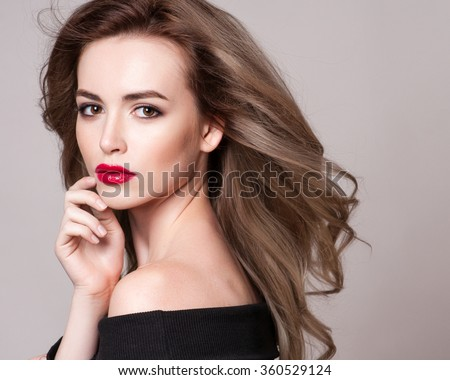 Portrait of beautiful blonde woman with curly hairstyle and bright makeup, perfect skin, skincare, spa, cosmetology. Sexy vogue woman face, sensual beauty girl model. Natural look. studio, isolated. - stock photo
