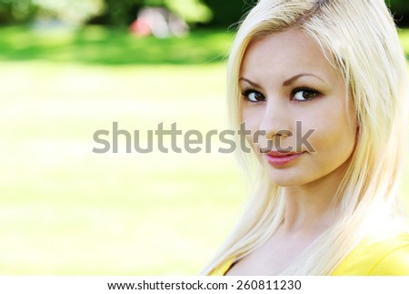 Portrait of beautiful blonde young woman. Outdoor - stock photo