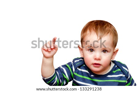 Portrait of beautiful boy pointing finger. Isolated - stock photo