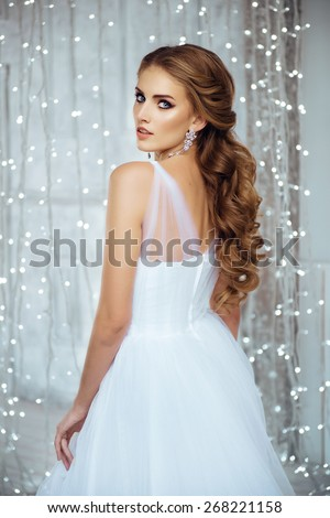 Portrait of Beautiful Bride in Lights. Fashion Dress and MakeUp - stock photo