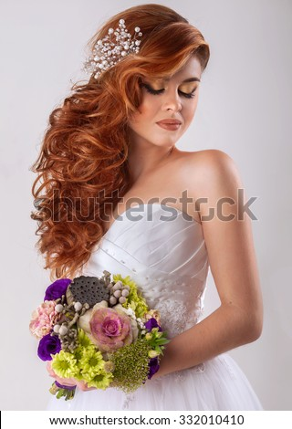 Portrait of beautiful bride. Wedding dress. Wedding decoration. Luxury hairstyle and bouquet of flowers - stock photo
