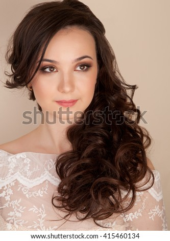 Portrait of beautiful bride with curly hairstyle and makeup - stock photo