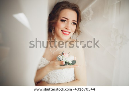 Portrait of beautiful bride with fashion veil and dress at wedding morning
