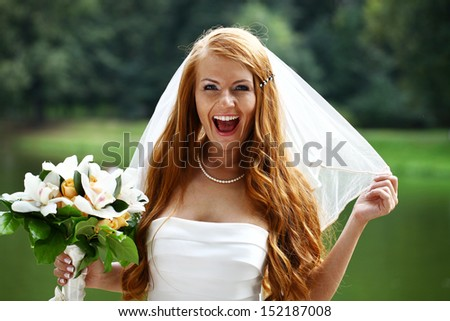 Portrait of beautiful bride with flowers - stock photo