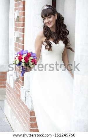 Portrait of beautiful bride with flowers