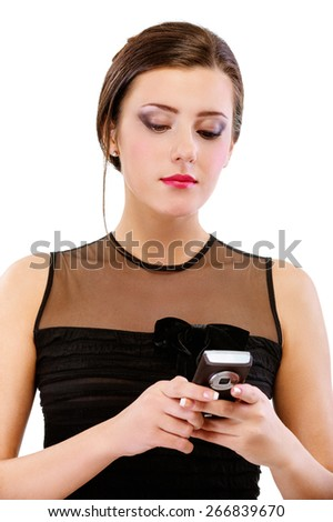 portrait of beautiful brunette girl in black cocktail dress speaking on mobile - stock photo