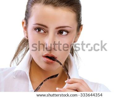 portrait of beautiful brunette girl in glasses posing on white - stock photo