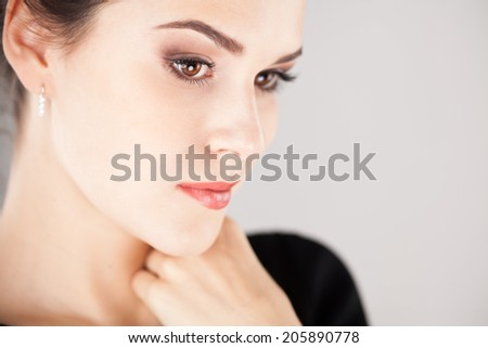 Portrait of beautiful brunette girl. Studio shot - stock photo