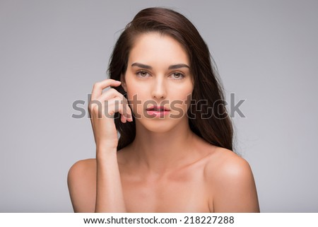 Portrait of beautiful brunette looking at the camera - stock photo