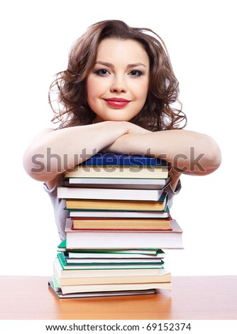 portrait of beautiful brunette student girl with books - stock photo