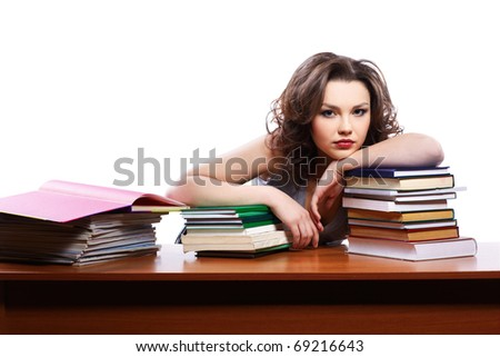 portrait of beautiful brunette student girl with books