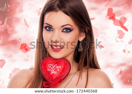 "Portrait of beautiful brunette with ""I Love You"" heart and flying hearts around her - stock photo"