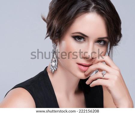 Portrait of beautiful brunette woman in black dress. Cosmetic Eyeshadows. Fashion photo - stock photo