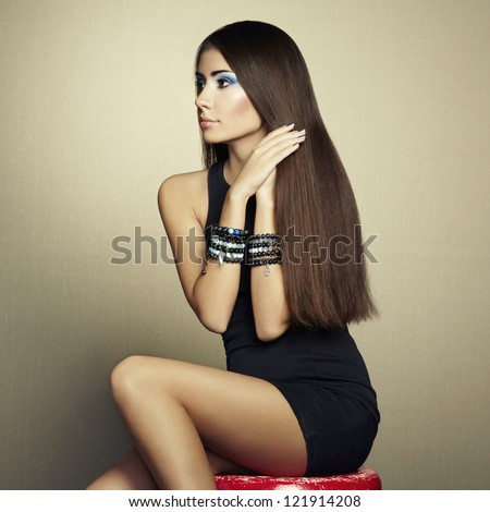 Portrait of beautiful brunette woman in black dress. Fashion photo - stock photo
