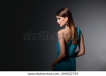 Portrait of beautiful brunette woman in blue dress - stock photo