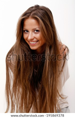 Portrait of beautiful brunette woman in studio, isolated on white - stock photo