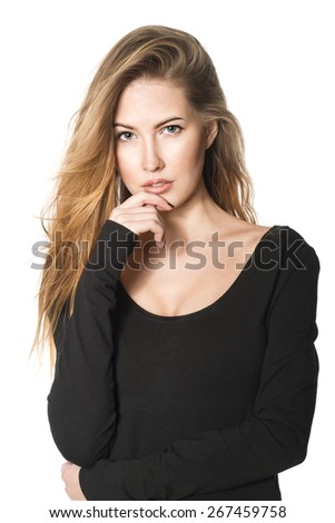 Portrait of beautiful brunette woman with long hair in black blouse - stock photo