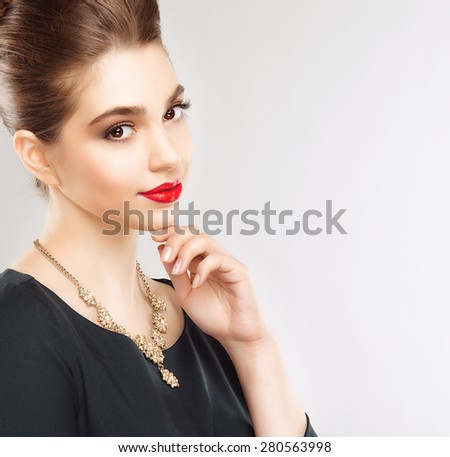 Portrait of Beautiful Brunette Woman with Perfect Makeup and Hairstyle. Close Up Isolated on White Background - stock photo