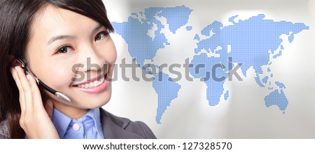 portrait of beautiful business woman operator in headset smile face with world map background, asian beauty model