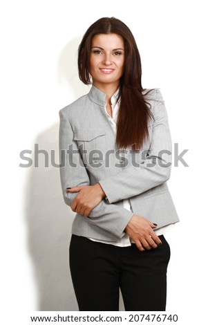 Portrait of beautiful business woman standing with folded arms, isolated on white - stock photo