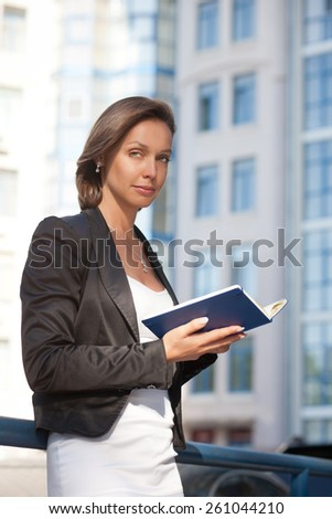 Portrait of beautiful business woman with diary