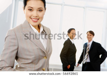 Portrait of beautiful businesswoman in suit looking at camera
