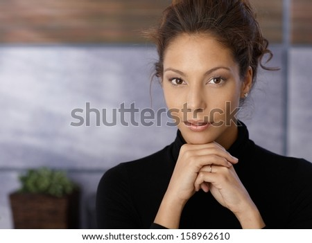 Portrait of beautiful businesswoman looking at camera.
